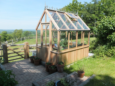 An Alton 68 Evolution Victorian greenhouse
